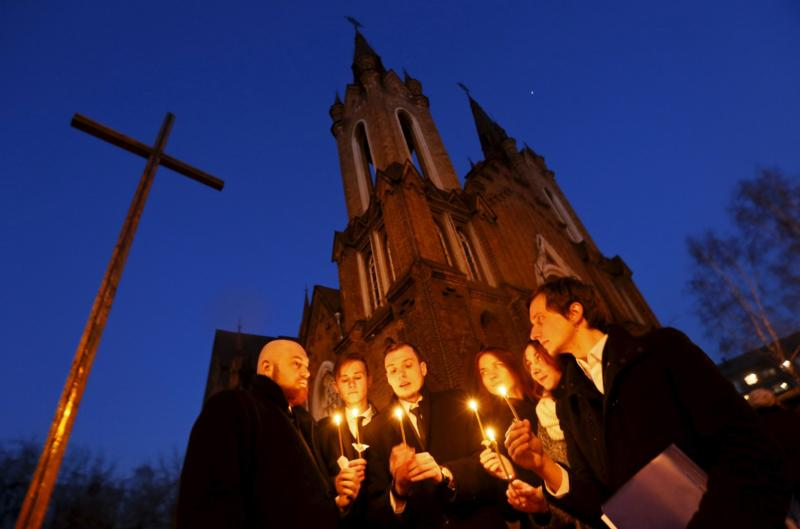 People light candles in front of a Catholic church during the Easter Vigil in the Siberian city of Krasnoyarsk, Russia, April 4, 2015. Many people may think of Easter as simply about the resurrection of Christ from the tomb, but the readings assigned to this great feast depict a much broader view. (CNS photo/Ilya Naymushin, Reuters)