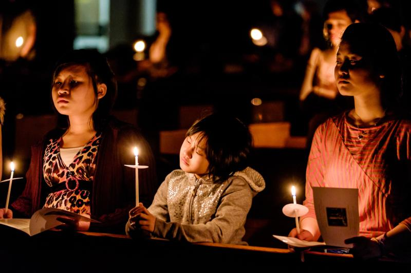 Young people hold candles during the Easter Vigil April 4, 2015, at the Cathedral of St. Joseph in Hartford, Conn. The readings of the Easter Vigil, by their sheer length and number, cover a lot of theological territory, but each of them offers something significant for us in terms of what it means to be merciful and thankful. (CNS photo/Bob Mullen)