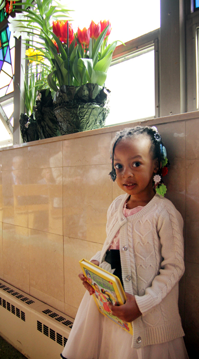 Aziza brought her children's bible to Easter Sunday mass.