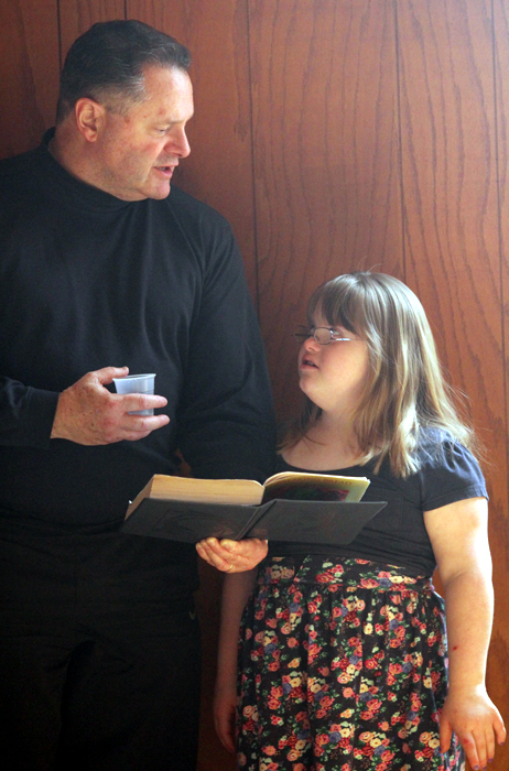 John and Isabelle Maggi read along with the scriptures.