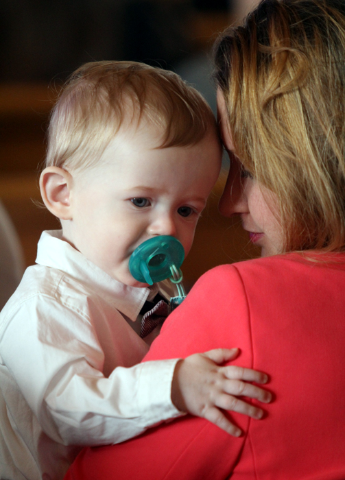 Hannah Casey shares a moment with her son Donald at Easter Sunday mass.