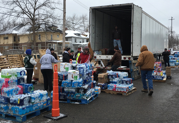 Volunteers stack water bottles in Lansing, Mich., Feb. 15. (CNS photo/courtesy FAITH Catholic)