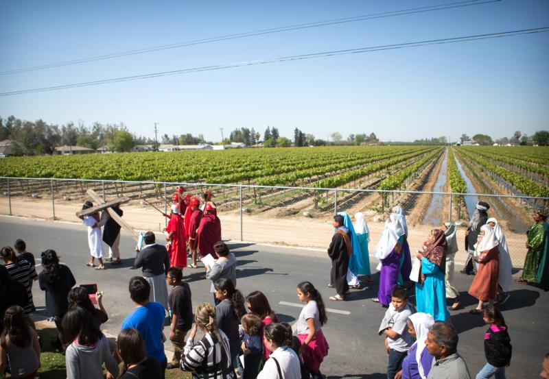 A person carrying a cross leads the Way of the Cross procession on Good Friday in the Diocese of Fresno, Calif., in this April 3, 2015, photo. The tradition of a living Stations of the Cross is especially strong in the diocese's migrant communities. (CNS photo/Rich Kalonick, Catholic Extension)