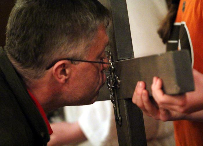 Jim Rinier, from Blessed Teresa of Calcutta Church in Collingswood NJ, venerates the cross at Saint Katharine Drexel Shrine.