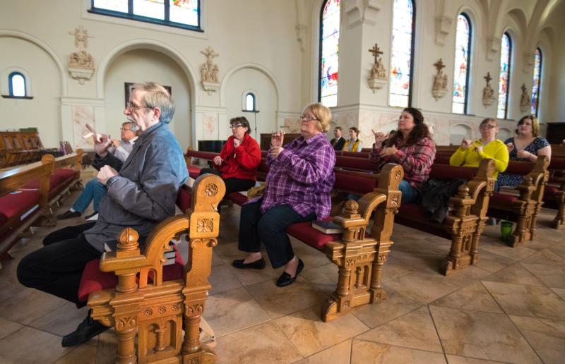 Members of the deaf community use sign language to participate in the Stations of the Cross held March 11 at St. John the Evangelist Church in Green Bay, Wis. (CNS photo/Sam Lucero, The Compass)