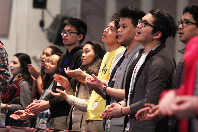 Teenagers from across the Archdiocese of Philadelphia raise their spirits at the fourth annual Generation Phaith youth rally Feb. 27 at Cardinal O'Hara High School. (Photo by Sarah Webb)