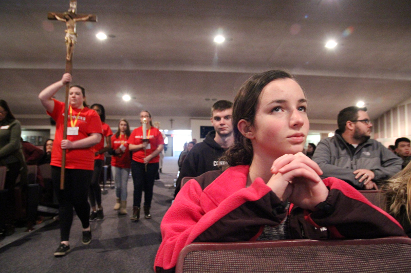 A holy hour led by Father Stephen DeLacy allowed time for prayer and reflection before the Eucharist at the Generation Phaith rally Feb. 27 at Cardinal O'Hara High School. (Sarah Webb)