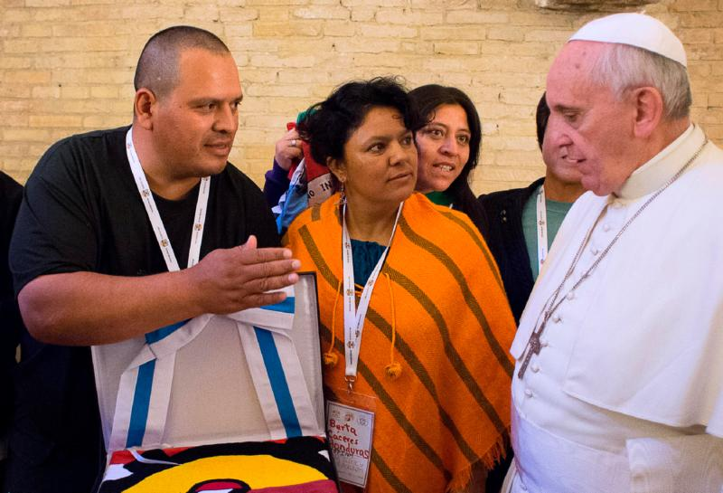 Berta Caceres, center, a Honduran indigenous rights activist and environmentalist, looks toward Pope Francis during the pope's meeting with social activists at the Vatican in this Oct. 28, 2014, file photo. She was murdered at her home in La Esperanza, Honduras, March 3. (CNS photo/L'Osservatore Romano)