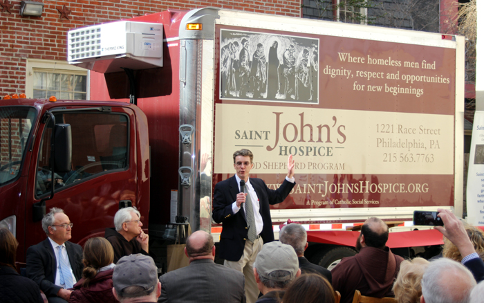 St. John's Hospice Director David Stier shows off the new truck that will be used to deliver meals from families throughout the archdiocese to the homeless men in center city. A grant funded the truck and improvements to the  Catholic shelter's HVAC system. (Matthew Gambino)