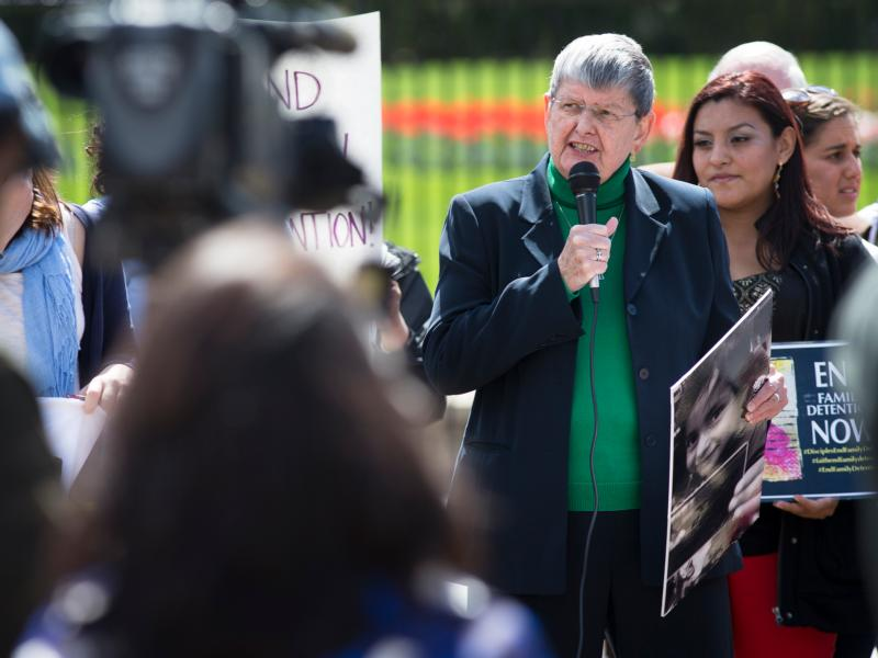 Sister Eileen Campbell, of the Sisters of Mercy of the Americas, speaks during a rally in front of the White House in Washington March 28 calling for an end to the detention of immigrant families who are seeking asylum. (CNS photo/Tyler Orsburn)
