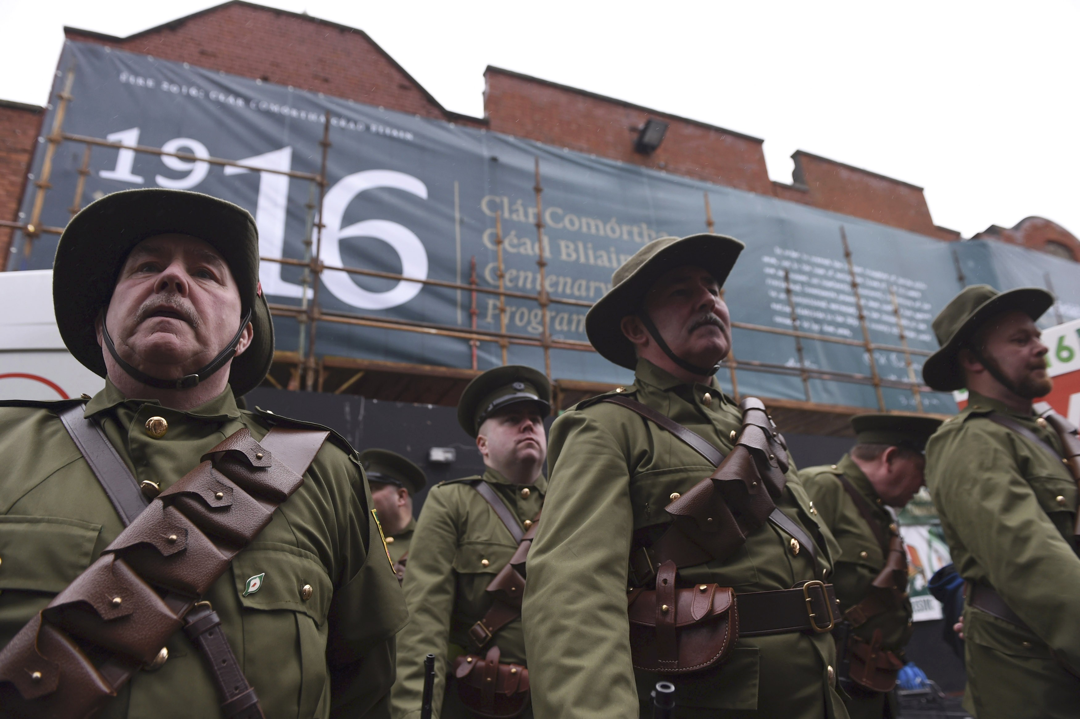 Members of the Finglas 1916 commemoration group attend a Sinn Fein rally to save Moore Street in Dublin Jan. 31. Ireland's political system emerged from the rubble of the anti-British 1916 Easter Rising, which is marking its centenary this year. (CNS photo/Clodagh Kilcoyne, Reuters)