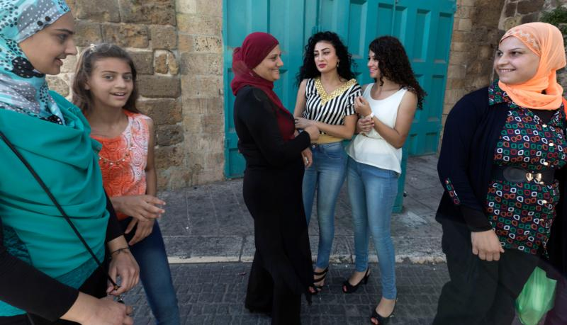 Arab woman mix with more traditionally dressed women in Akko, Israel, in this Aug. 9, 2013, file photo. (CNS photo/Jim Hollander, EPA).