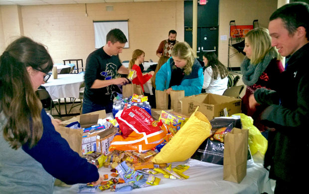 "Young adults prepare bags  of personal items and religious articles Feb. 19 for the ""Jesus Run,"" a monthly outreach to the homeless in center city Philadelphia."