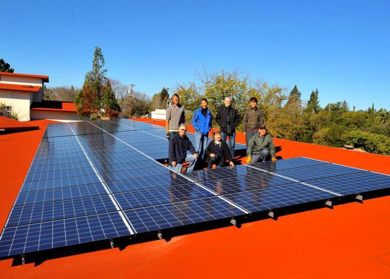 "Parishioners of St. Thomas Aquinas in Palo Alto, Calif., pose next to solar panels in this undated 2015 file photo. The Archdiocese of San Francisco is launching a ""Laudato Si'"" initiative to help parishes respond to Pope Francis' 2015 encyclical and form ""care for creation"" teams. (CNS photo/courtesy St. Thomas Aquinas Parish)"