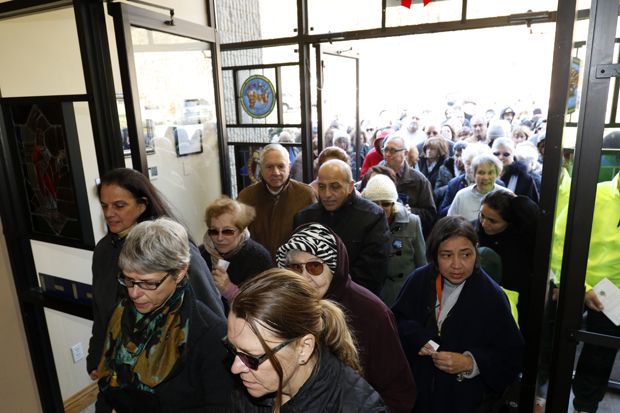 Pilgrims pass through the Door of Mercy after it was officially opened Dec. 19 at Our Lady of the Island Shrine in Manorville, N.Y. The shrine is one of four sites designated by the Diocese of Rockville Centre, N.Y., to be places of pilgrimage during the Year of Mercy. (CNS photo/Gregory A. Shemitz, Long Island Catholic)