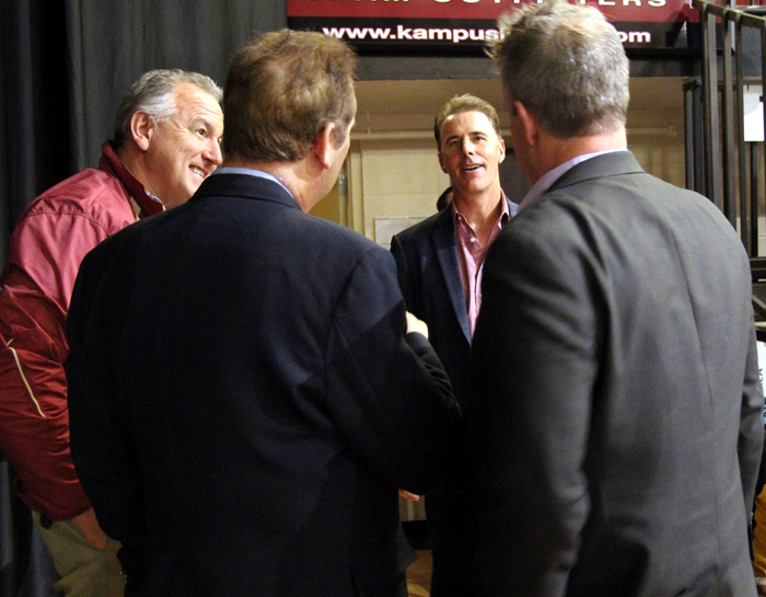 Rich Gannon (center) chats with men after he spoke at Man Up Philly.