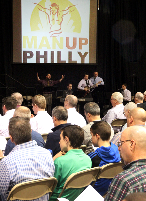 The Man Up Philly Band leads the men in song.