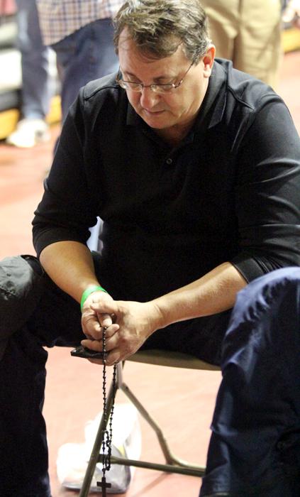 Bob Nowak from St Teresa of Avila Parish in East Norriton prays the rosary before Mass.