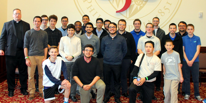 Father Stephen DeLacy poses with young men attending Saint Charles Seminary and those discerning that attended Man Up Philly.