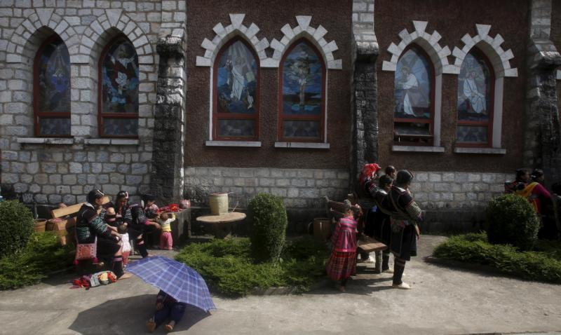 Ethnic Hmong attend Mass outside a church in Sapa, Vietnam, in this Oct. 18, 2015, file photo. The former head of the Federation of Asian Bishops' Conferences has challenged the continent's church leaders to evangelize by being a church of the poor. (CNS photo/Kham, Reuters)