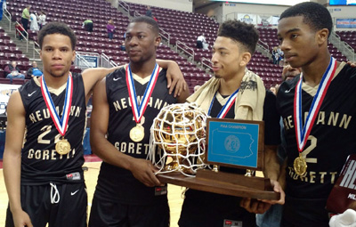 Some members of the Neumann-Goretti boys squad proudly gather around the championship trophy they earned at the PIAA state finals March 18 in Hershey, Pa.