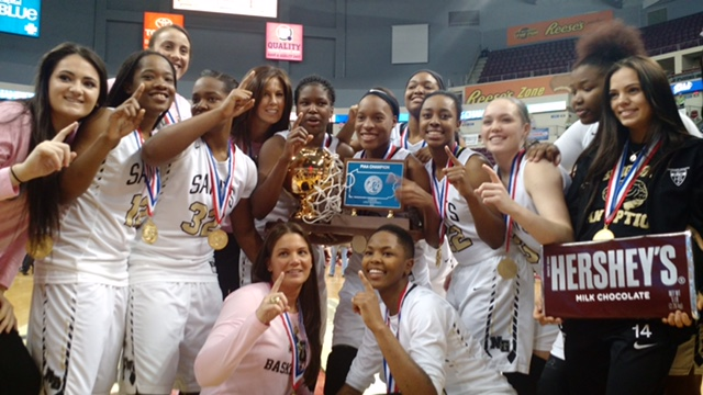 The girls of Neumann-Goretti, and their coach Andrea Peterson (center back) celebrate their second consecutive state championship March 18 in Hershey, Pa.