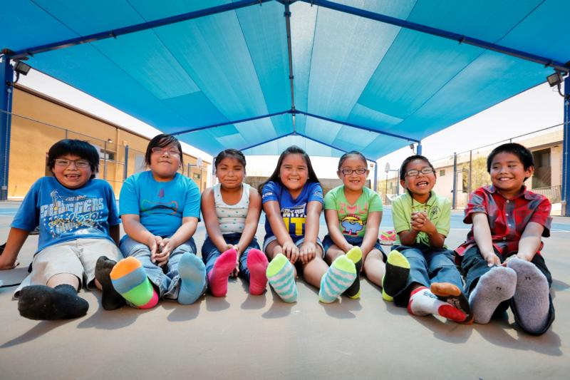 Students of St. Peter Indian Mission School sit under the shaded basketball court in 2015 that was built with help from Joe Garagiola in the Gila River Indian Community in Bapchule, Ariz. (CNS photo/Nancy Wiechec)