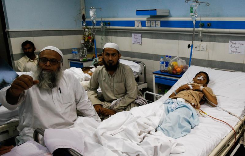 "A boy who was injured in a suicide bomb attack at a public park in Lahore, Pakistan, on Easter, rests in his bed March 28 at a hospital in the city. Archbishop Sebastian Shaw of Lahore visited young victims at a hospital and described his experience as ""truly difficult."" (CNS photo/Omer Saleem, EPA)"