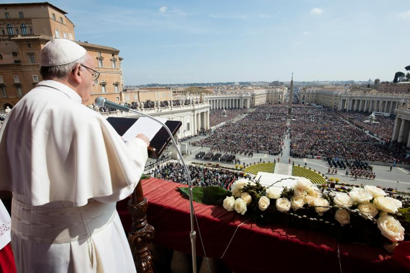 """Pope Francis delivers his Easter message """"urbi et orbi"""" (to the city and the world) from the central balcony of St. Peter's Basilica at the Vatican March 27. (CNS photo/L'Osservatore Romano, handout)"""