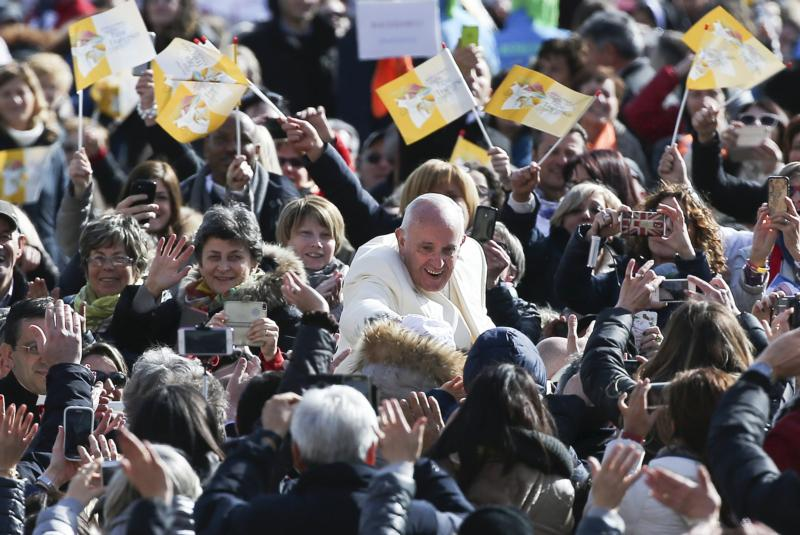 Pope Francis waves as he arrives to lead a jubilee audience in St. Peter's Square at the Vatican March 12. (CNS photo/Alessandro Bianchi, Reuters)