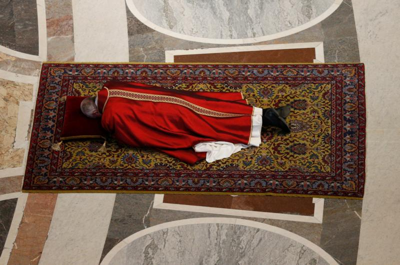 Pope Francis lies prostrate at the beginning of the Good Friday service in St. Peter's Basilica at the Vatican March 25. (CNS photo/Paul Haring)