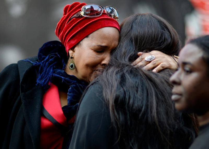 In this Oct. 22, 2015, file photo, mothers who lost their sons to police shootings hug one another during an event in New York City where names of people who died from police violence were read aloud in Times Square. (CNS photo/Justin Lane, EPA)