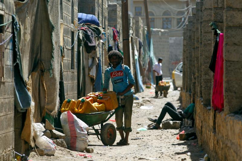 A man stands next to a wheelbarrow in a shantytown in Sana'a, Yemen, Feb. 6. Addressing the needs and challenges of the poor and of refugees is a commitment not only for Christians but for all men and women, Pope Francis told university students. (CNS photo/Yahya Arhab, EPA)