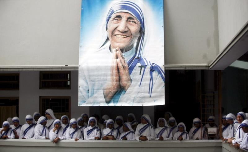 A poster of Blessed Teresa of Kolkata and Missionaries of Charity are seen in Kolkata, India, in this Sept. 5, 2007, file photo. Pope Francis will declare her a saint at the Vatican Sept. 4, the conclusion of the Year of Mercy jubilee for those engaged in works of mercy. (CNS photo/Jayanta Shaw, Reuters)