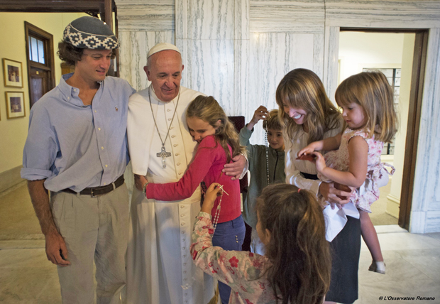 Pope Francis meets the Walker family of Buenos Aires, Argentina, Sept. 27, 2015 at St. Charles Borromeo Seminary outside Philadelphia. Catire, Noel and their four children -- Cala, 12, Dimas, 8, Mia, 5, and Carmin, 3 -- traveled 13,000 miles to be with Pope Francis during the World Meeting of Families. (CNS photo/L'Osservatore Romano, handout)
