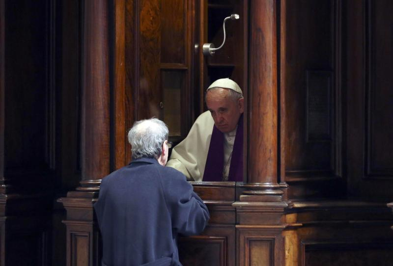 Pope Francis hears confession during a penitential liturgy in this early March 2015 file photo in St. Peter's Basilica at the Vatican.(CNS photo/Alessandro Bianchi pool via EPA)