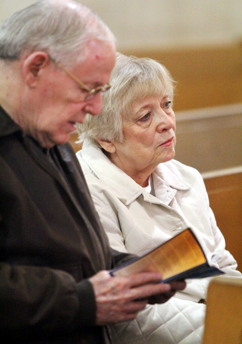 Frank and Liz Canavan pray before the Blessed Sacrament at St. Francis of Assisi Church in Springfield, Delaware County. (Sarah Webb)