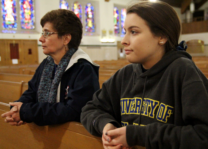 Mother and daughter Maria and Katie Lynch of St. Francis Parish spend time adoring Christ in the Eucharist on March 5 as part of the 24 Hours for the Lord, which Pope Francis called for as a devotion during the Year of Mercy. (Sarah Webb)