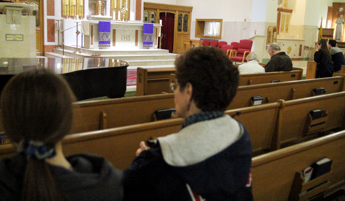 Catholics take some time on a Saturday afternoon to pray before the Blessed Sacrament at St. Francis of Assisi Parish in Springfield, Delaware County, which was participating in the worldwide observance of 24 Hours for the Lord. (Photo by Sarah Webb)