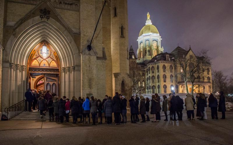 Students wait in line outside the Basilica of the Sacred Heart on the campus of the University of Notre Dame in this March 3, 2015, file photo. Bishop Kevin C. Rhoades of Fort Wayne-South Bend, Ind., said he disagreed with University of Notre Dame officials for deciding to honor Vice President Joe Biden with the Laetare Medal for outstanding service to the Catholic Church and society. (CNS photo/Barbara Johnston, University of Notre Dame)