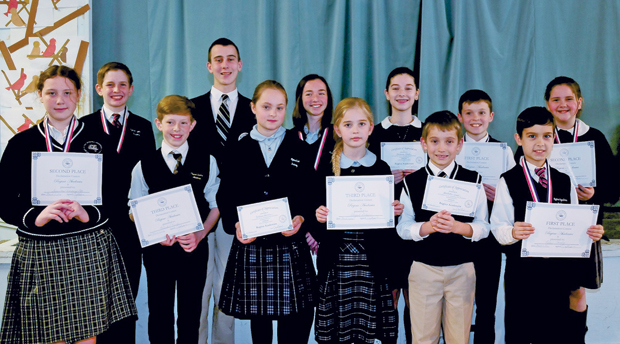 Students of the four Regina Academies int he Philadelphia Archdiocese show the commendations they earned at a public speaking contest this month.