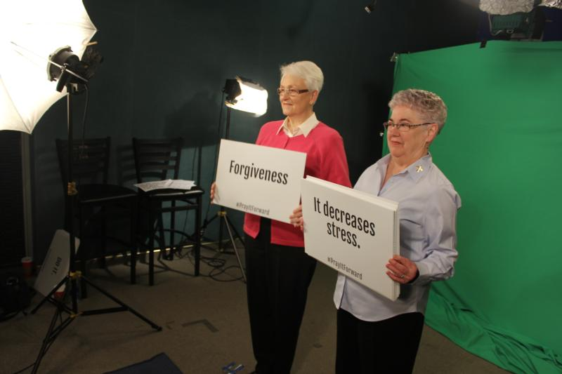 "Sister Mary Ann Vogel of Davenport, Iowa, who belongs to the Congregation of the Humility of Mary, participates in a ""Pray It Forward"" video shoot Jan. 13 with Dominican Sister Mary Hopkins of Sinsinawa, Wis., at Loras College in Dubuque. (CNS photo/Jessi Russo, The Witness)"