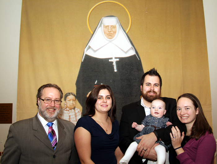 Robert Gutherman (left) and Amy Wall (center), recipients of a divine miracle attributed to St. Katharine Drexel's intercession, celebrates the saint's feast day Mass with Amy's brother Jack, his wife Christina and their daughter Katharine. (Photo by Sarah Webb)