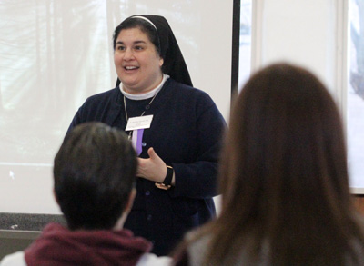 "Immaculate Heart Sister Danielle Therese Teti, a teacher at Villa Maria Academy High School in Malvern, gives the talk ""Saints Lived God's Mercy and So Can You!"" March 5 at the Catechist Convocation at Archbishop Carroll High School. (Sarah Webb)"