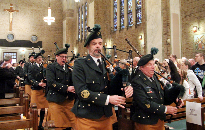 Emerald Society Pipe Band leads the procession before Mass.