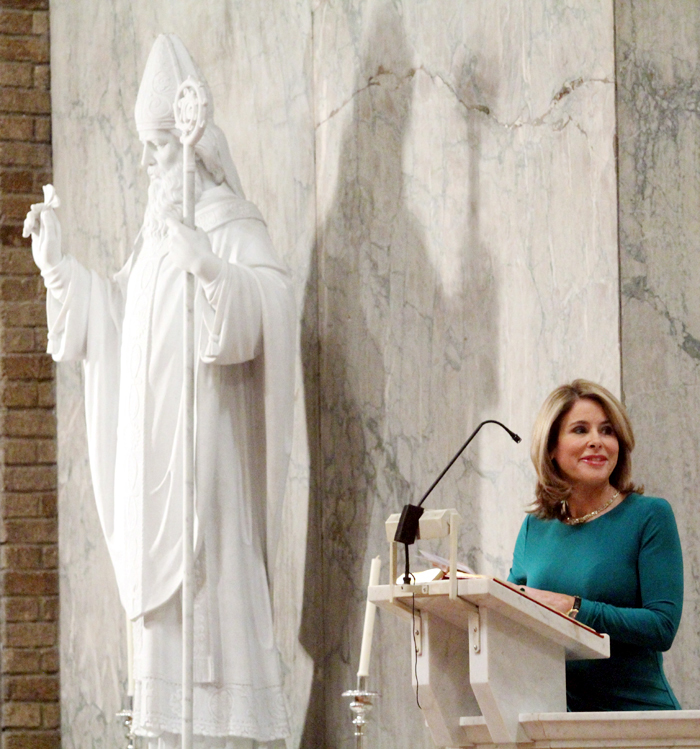 Kathy Orr reads the 1st reading during the Saint Patrick Mass.