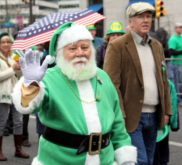 Even Saint Nicholas, Joe Belisari, dressed in green as he marched with Saint Thomas Moore Alumni.