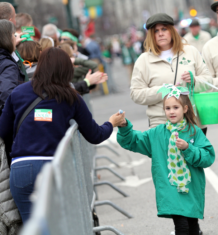 Brianna Owens from St Anselm Church hands out lollipops as she marches in the parade.