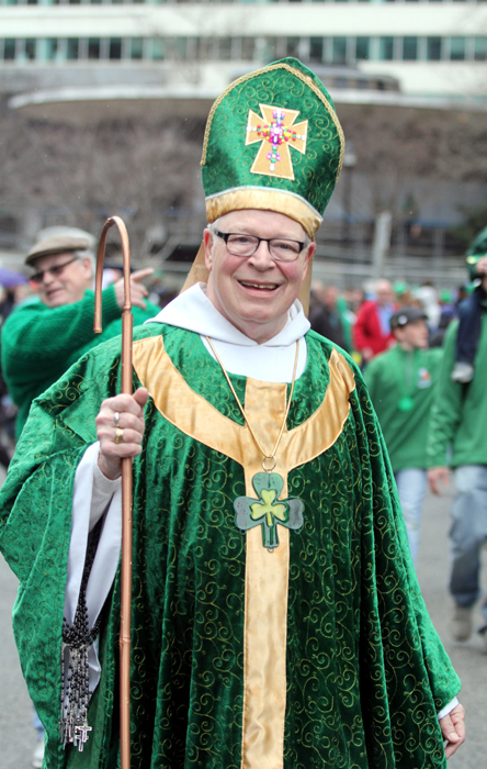 Michael Rocks marches as St Patrick with the Steamfitters Union.