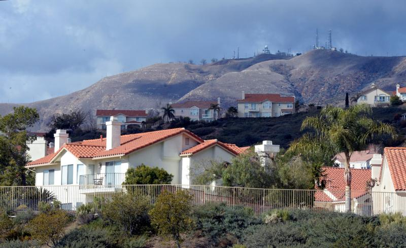 "General view of homes affected by a mountain gas leak in Porter Ranch, Calif., Jan. 7. For all the attention Pope Francis' encyclical ""Laudato Si', on Care for Our Common Home"" has gained, little has been made of the connection among Catholic tradition, the natural world and science that the document addresses. (CNS photo/Mike Nelson, EPA)"